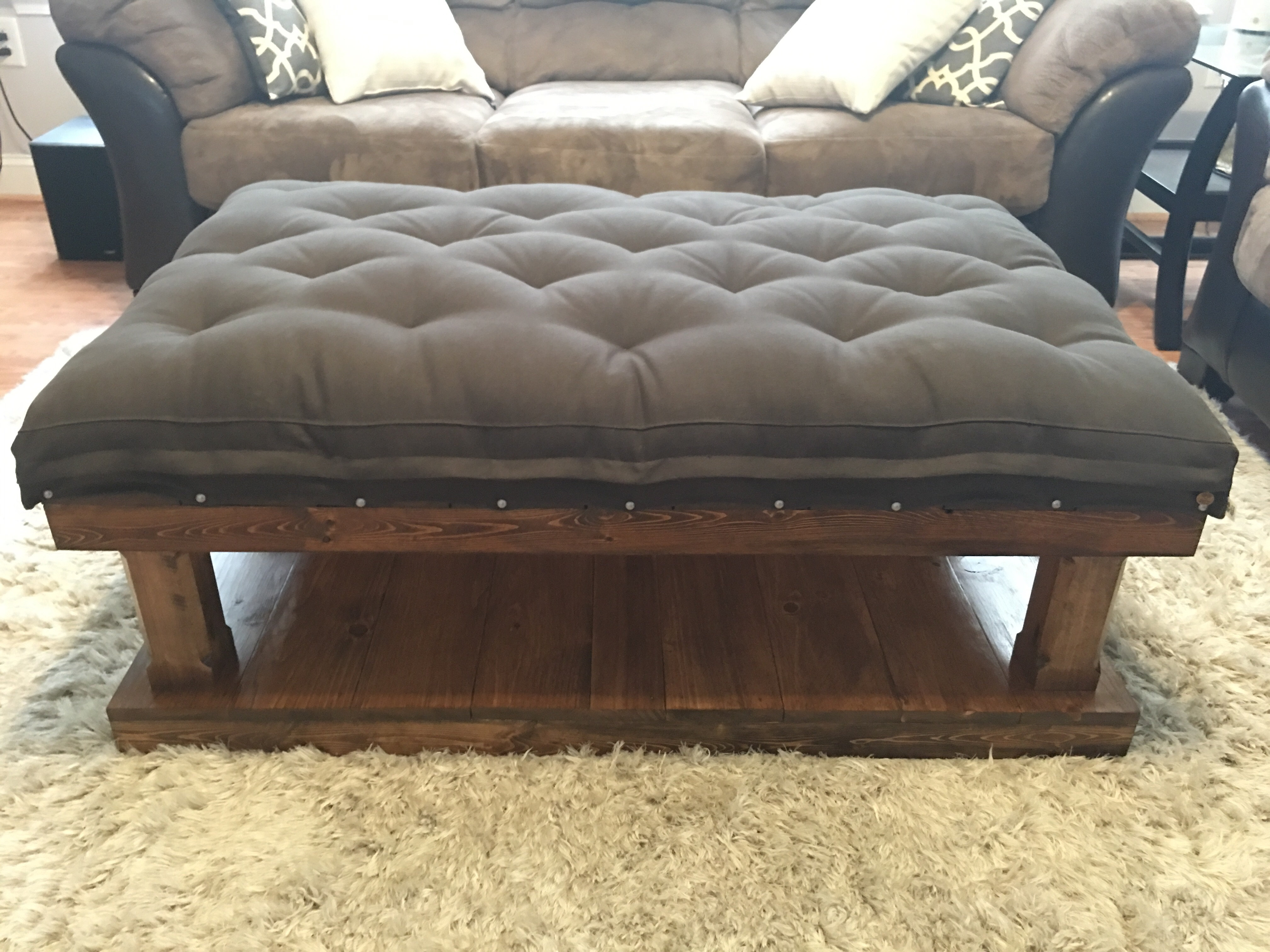wool-filled tufted coffee table cushion