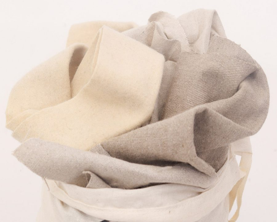 Home of Wool bag of fabric scraps - wool, linen, silk and cotton fabrics detail