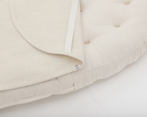 Home of Wool natural stokke sized mattress with wool mattress protector - closeup detail