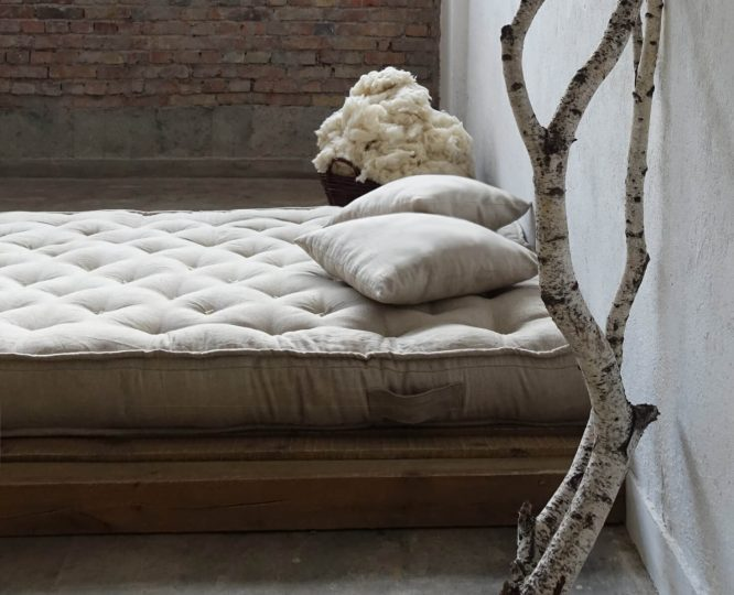 all-natural tufted wool-filled mattress