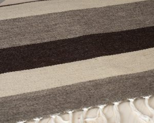 flatweave wool rug with natural stripes -close up