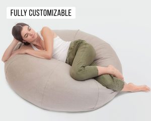 Home of Wool Natural Round Bean Bag Chair with Linen cover with model laying down