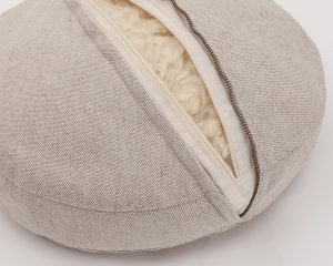 Natural zafu meditation cushion - zipper detail and natural stuffing