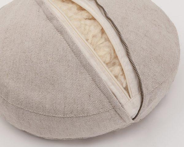 Natural zafu meditation cushion - zipper detail and natural stuffing