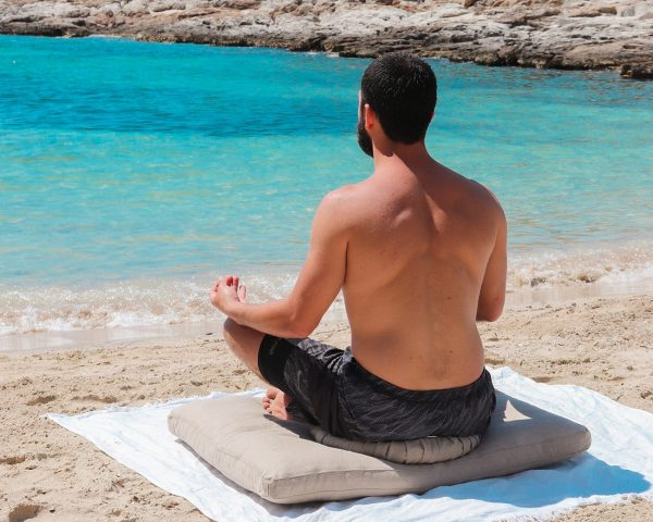 Home of Wool natural yoga cushions with natural wool filling zafu and zabuton with male model