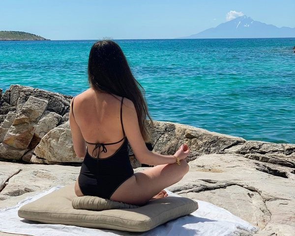 Home of Wool natural yoga cushions with natural wool filling zafu and zabuton with female model