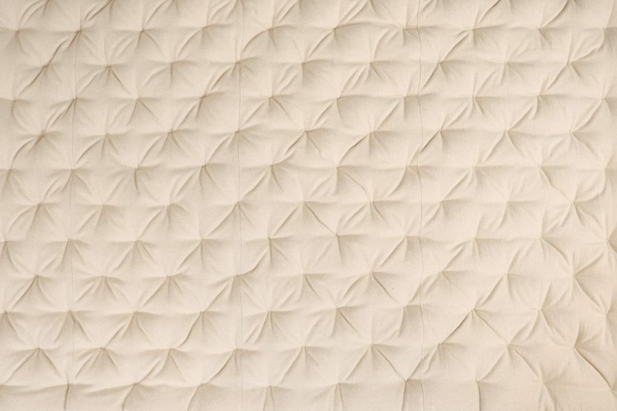 wool mattress with stitched fabric cover