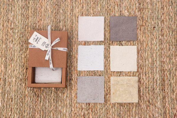 Home of Wool montessori fabrics box - fabrics and batting lined up
