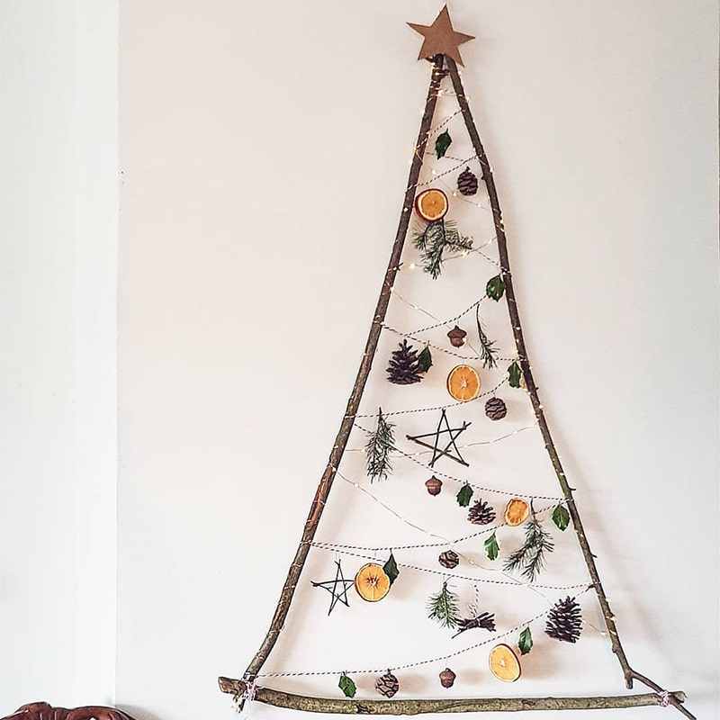 Holidays Go Zero Waste - handmade Christmas tree with branches, pinecones and oranges